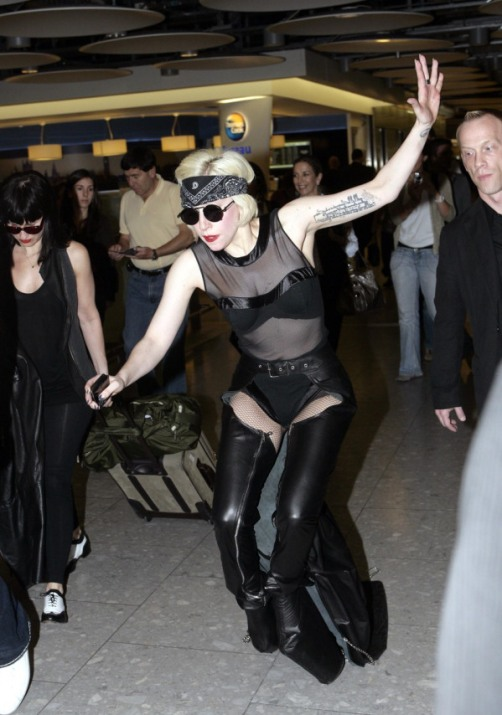 June 23, 2010: Lady Gaga trips over her massive platform boots and falls hard on the ground as she arrives at Heathrow airport in London, UK this morning on a flight from New York City.